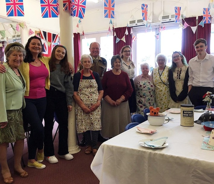 Volunteers and older community at Tea Party